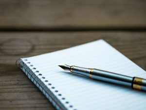 Fountain pen on spiral notebook