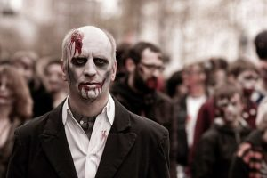 City zombie in a dark suit, no tie.