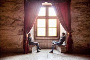 Two people talking in a window nook