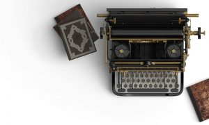 Old-fashioned typewriter with books